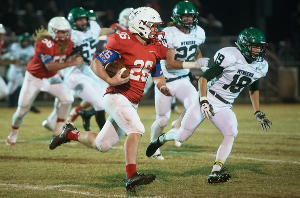 Globe/Roger Nomer<br /> Seneca's Trey Wilson rushes the ball by Mt. Vernon's Jayden Buttram during Friday's game in Seneca.