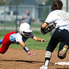 Webb City's Mariah Newby dives back to second base after opting not to stretch her double into a triple during the Cardinals' Class 4 District 12 championship game on Saturday at Carthage. Also pictured is Neosho second baseman Megan Geller (15.)<br /> Globe | Laurie Sisk