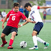 Jopln senior midfielder Gabriel Avila (9) works to get past West Plains midfielder Tommy Keller (6) during their match on Tuesday night at JHS.<br /> Globe | Laurie Sisk