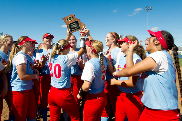 Webb City players hoist their Class 4 District 12 championship trophy after beating Neosho 9-4 on Saturday at Carthage.<br /> Globe | Laurie Sisk