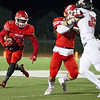 Rayquion Weston(13) runs the ball to the outside with help of a block by Kobe Maxwell(4) on West Plains's Lane Jett(39) in Friday nights game in Carl Junction.