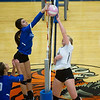 Globe/Roger Nomer<br /> Carthage's Paige Schrader blocks Neosho's Ashley Sims at the net as teammate Gracie Fagg looks on during Tuesday's match in Carthage.