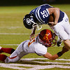 Globe/Roger Nomer<br /> Galena's Joseph Helton tries to escape a tackle from Columbus' Shawn Robinson during Friday's game in Galena.