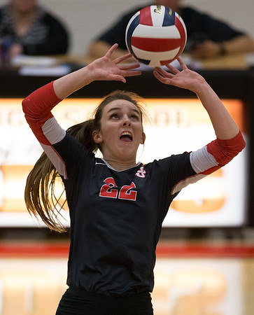 Carl Junction's Sylvia Lawson (22) sets the ball for a teammate  during their Class 4 District 12 tournament match against McDonald County at Carl Junction High School.