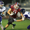 Joplin's Spencer Cornett (11) tries to elude Camdenton defendersTodd Simpson (41) and Jackson Ezard (25) during their game on Friday night at Junge Field.<br /> Globe | Laurie Sisk