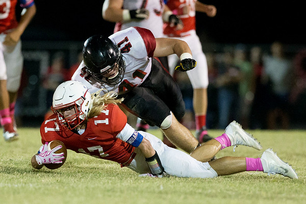 Globe Israel Perez<br /> Seneca's Matt Caputo (17) takes a dive to gain extra yards on Lamar's territory as TW Ayers (41) dives in to make contact during their Big 8 championship game on Friday night at Tom Hodge Field.
