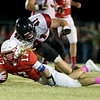 Globe|Israel Perez<br /> Seneca's Matt Caputo (17) takes a dive to gain extra yards on Lamar's territory as TW Ayers (41) dives in to make contact during their Big 8 championship game on Friday night at Tom Hodge Field.