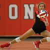 Carl Junction's Olivia Lewis (12) digs a spike during their Class 4 District 12 tournament match against McDonald County at Carl Junction High School