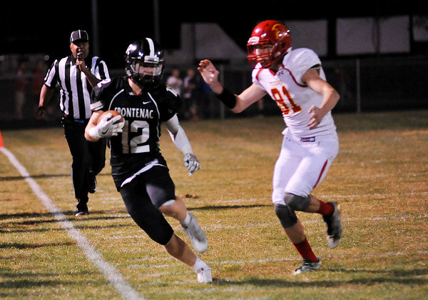 Globe | Willie Brown<br /> Frontenac's Jake Wilbert carries the ball down the line as Columbus' AustinLagle tries to tackle during Friday's game in Frontenac.