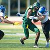 Missouri Southern receiver Donavan carter (3) tries to get past Nebraska-Kearney's Malik Webb  (18) and Zach Sullivan (15) during their game on Saturday at Fred G. Hughes Stadium.<br /> Globe | Laurie Sisk