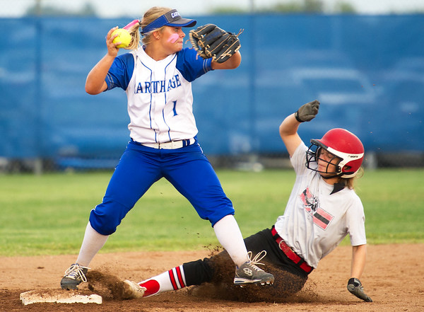 Carthage second baseman Maddison Adams gets the force out on McDonald County's Chloe Colvin during their Class 4 District 12 game on Thursday night at Carthage.<br /> Globe | Laurie Sisk