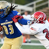 Northeastern Oklahoma A&M receiver Tariq Bitson (83) breaks free for a first quarter touchdown Navarro's Eryk Preston (27) defends during their game on Saturday night at NEO.<br /> Globe   Laurie Sisk