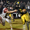 Cassville's Deven Bates (2) tries to get past Lamar's Wyatt Hull (26) after Bates intercepted a pass in the final seconds of  of their game on Friday night at Cassville.<br /> Globe | Laurie Sisk