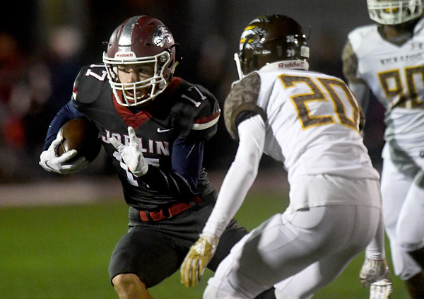 Joplin's Jake Flowers (17) looks to get past Kickapoo's Grant Cox (20) for a long gain during their game on Friday night at Junge Stadium.<br /> Globe | Laurie Sisk