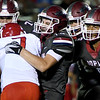 Joplin's Luke Kuehnel (19) brings down Ozark's Max Schilling (7) as teammates Jacob Booe (74) and James Boyd (9) close in during their game on Friday night at Junge Field.<br /> Globe | Laurie Sisk