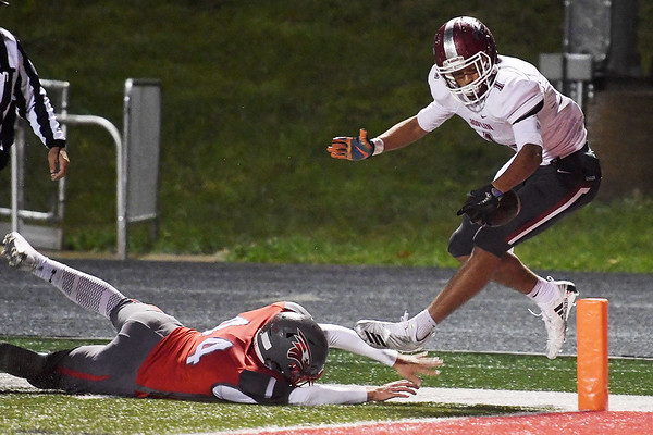 Joplin's Zach Westmoreland (1) spins away from Nixa's Trent McFall (44) and into the endzone before the play was called back on a holding penalty during their game on Friday night at Nixa.<br /> Globe   Laurie Sisk