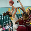 Missouri Southern's Krista Clark goes up for a shot against Henderson State's Pink Jones (2) and Karrington Whaley (30) during Friday's game at the Leggett and Platt Athletic Center.<br /> Globe | Roger Nomer