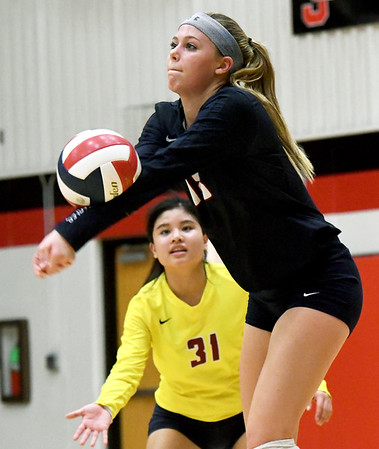 Joplin's Mallory Cravens (18) returns a serve as libero Jeanie Juneweeranong (31) looks on during their match against Carl Junction on Tuesday night at CJHS.<br /> Globe | Laurie Sisk