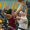 Missouri Southern's Jordan Schoenberger goes up for rebound against Henderson State's Karrington Whaley during Friday's game at the Leggett and Platt Athletic Center.<br /> Globe | Roger Nomer