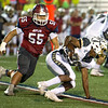 Joplin's Ethan Vang (55) tries to track down Lee's Summit runningback Bruce Andrews (25) during their game on Friday night at Junge Field.<br /> Globe   Laurie Sisk