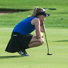 Carthage's Hailey Bryant lines up a putt on Monday at Schifferdecker Golf Course.<br /> Globe | Roger Nomer