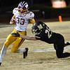 Monett's Jamie Guinn moves the ball down the field as Neosho's Cade Lyeria tries to tackle during Friday's game in Neosho.<br /> Globe | Willie Brown