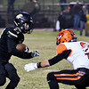 Neosho's Bret Camerer moves down the field as Republic's Riley Sigman tries to tackle during Friday's game in Neosho.<br /> Globe | Willie Brown