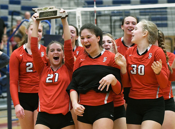Members of the Carl Junction volleyball team celebrate their Class 4 District 11 championship on Thursday after defeating Carthage at Joplin High School.<br /> Globe | Laurie Sisk