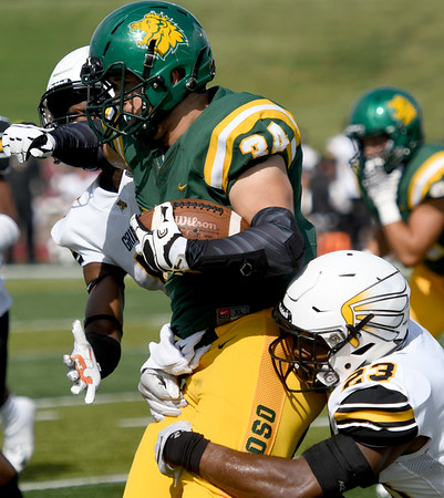 Missouri Southern's Dalton James (34) tries to break free from Missouri Western's Anthony Williams (23) during their game on Saturday at Fred G. Hughes Stadium. <br /> Globe | Laurie Sisk