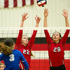 Carl Junction's Sylvia Lawson (22) and Grace Southern (29) try to block a spike by Carthage's Ava Petticrew during their Class 4 District 12 Championship match on Wednesday night at CJHS.<br /> Globe | Laurie Sisk