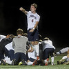 Joplin's Jackson Reynolds (4) leaps into the air as his teammates celebrate their Class 4 District 11 semifinal win over Republic on Tuesday at JHS.<br /> Globe   Laurie Sisk