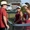 Joplin tennis coach Ed Ingle strategizes with his doubles team of Astrid Cardenas, center, and Ashley Butler during a match against Carthage last week at JHS.<br /> Globe | Laurie Sisk