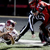 Joplin's Nathan Glades (6) dives for extra yards as Nixa's Kolyn Eli (26) defends during their game on Friday night at Nixa.<br /> Globe | Laurie Sisk