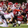 Joplin's Zach Westmoreland (1) runs the ball as he is stopped by Carl Junction's defensive lineman Colton Kennedy (22) and Isiac Shields (29) during their game on Friday night at Junge Field.<br /> Globe|Israel Perez