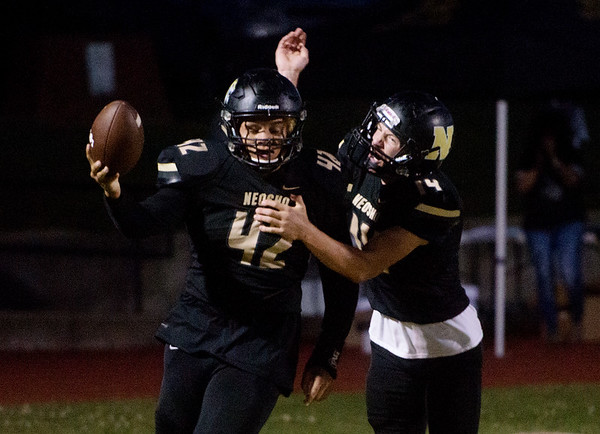 Neosho's Tre'Von Letts (42) and Quincey Willis (14) celebrate Letts' interception and touchdown against Carl Junction during Friday's game in Neosho.<br /> Globe | Roger Nomer