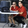 Joplin tennis coach Ed Ingle visits with his wife and assistant caoch Julie Ingle before a match against Carthage last week at JHS.<br /> Globe   Laurie Sisk