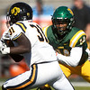 Missouri Southern's Keith Beverly (14) tries to stop Central Oklahoma's Justin Curry (31) during their game on Saturday at Fred G. Hughes Stadium.<br /> Globe | Laurie Sisk