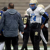 Northeastern Oklahoma A&M quarterback Guy Myers (14) chats with the coaching staff during practice on Wednesday at NEO.<br /> Globe | Laurie Sisk