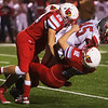 Webb City's Gibson Sweet (28) and Kade Hicks (12) tackle Nixa's Logan Ayers during Friday's game in Webb City.<br /> Globe | Roger Nomer