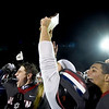 Joplin players celebrate their Class 6 District 3 Championship on Friday night at Junge Field.<br /> Globe | Laurie Sisk