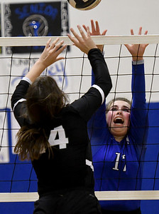 McAuley's Carmen Colson (17) and College Heights' Catie Secker (14) battle at the net during their match on Tuesday night at McAuley. Globe | Laurie Sisk