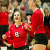 Carl Junction's Tailym Franklin (8) and Alexia Miller (14) celebrate a game one win during the Bulldogs' Class 4 District 12 Championship match against Carthage on Wednesday night at CJHS.<br /> Globe | Laurie Sisk