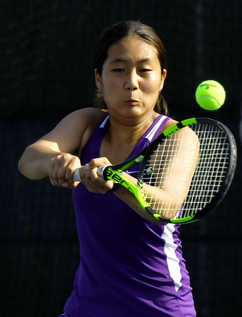 Thomas Jefferson's Jane Min returns a serve as she partners with Julianna Joseph during their no. 2 doubles match agaist Nevada's Erika Watanaba and Lexi Leighty on Wednesday at Millenium Tennis.<br /> Globe | Laurie Sisk