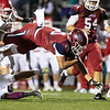 Joplin's Isaiah Davis (20) breaks through the defensive line of Carl Junction and takes a dive for extra yards during their game on Friday night at Junge Field.<br /> Globe|Israel Perez