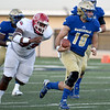 Northeastern Oklahoma A&M rquarterback Clayton Sims (10) gets past Navarro's Jarrus Singleton (99) for a long gain during their game on Saturday night at NEO.<br /> Globe   Laurie Sisk