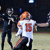 Neosho's Gage Kelly throws a complete pass as Republic's Brady Coggin (15) goes in for the tackle during Friday's game in Neosho.<br /> Globe | Willie Brown