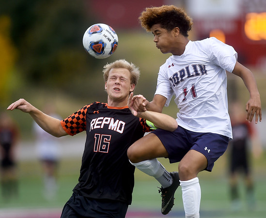 Joplin's Rashawn Davis (11) and Republic's Alexander Leonard (16) battle for the ball during their Class 4 District 11 semifinal match on Tuesday at JHS.<br /> Globe | Laurie Sisk