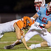 Globe | Israel Perez<br /> Webb City's Alex Gaskill (6) sacks Lucas Hayes of Republic during their game on Friday night at Cardinal Stadium.