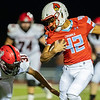 Cardinal's running back Kane Parks (42) runs the ball as he gets past the tackle of Michael Williams (31) of McDonald Co for a touchdown during their Class 4 District 6 game against McDonald Co. on Friday night at Cardinal Stadium.<br /> Globe | Israel Perez