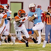 Globe | Israel Perez<br /> Webb City's Treyton Simmons (4) runs the ball gaining yards as he gets past Blake Hulland (4) of Republic during their game on Friday night at Cardinal Stadium.